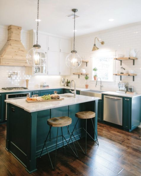 "With beautiful pops of color, minimalistic design, and gorgeous little touches (like those light fixtures!!), Chip and Joanna have redefined the term ""dream kitchen."" 