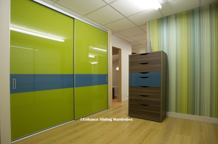 Green and Blue Glass Sliding Doors #wardrobe #bedroom #gloss // Designed by Enhance Sliding Wardrobes www.enhanceslidingwardrobes.com