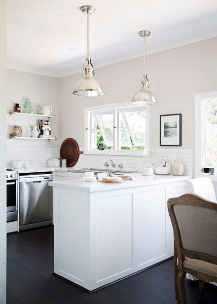 Small but stylish kitchen with gleaming finishes - Home Beautiful