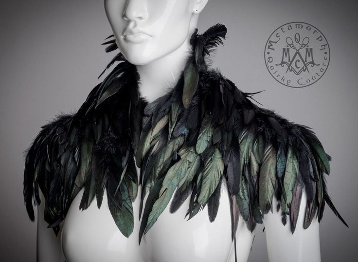 Spectacular black shrug with feathered shoulders that will make any outfit take to the sky. Designed and handcrafted by yours truly with high quality and attention to details. It has lots of black feathers, carefully layered and securely sewn on, because durability is just as important as looks. The feather shrug is held in place around the shoulders with ribbons that can be adjusted to just the right size with cord locks. The ribbons are decorated with feather tassels. So the shoulder…
