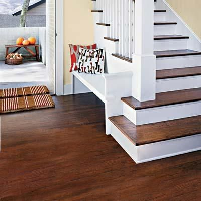 Add shine to dull wood floors with Bona's Pro Series Hardwood Floor Refresher (about $25; sears.com), which goes on with a microfiber mop, dries in an hour, and keeps floors gleaming for a couple of months. | Photo: Casey Dunn | thisoldhouse.com
