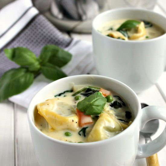 A creamy and filling pasta soup made with spinach and ricotta tortellini, fresh spinach, peas and carrots.
