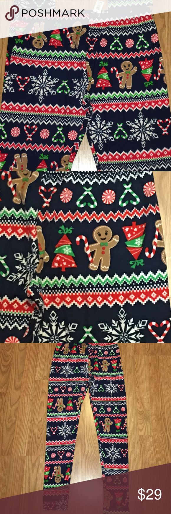 Buttery Soft Christmas Gingerbread Men Leggings New with tags!!!  Christmas leggings in a buttery soft sueded fabric like Lularoe. These feature Gingerbread men, candies, and Christmas trees on a navy blue background. 90% polyester and 10% spandex. Size large (11-13). Pants Leggings
