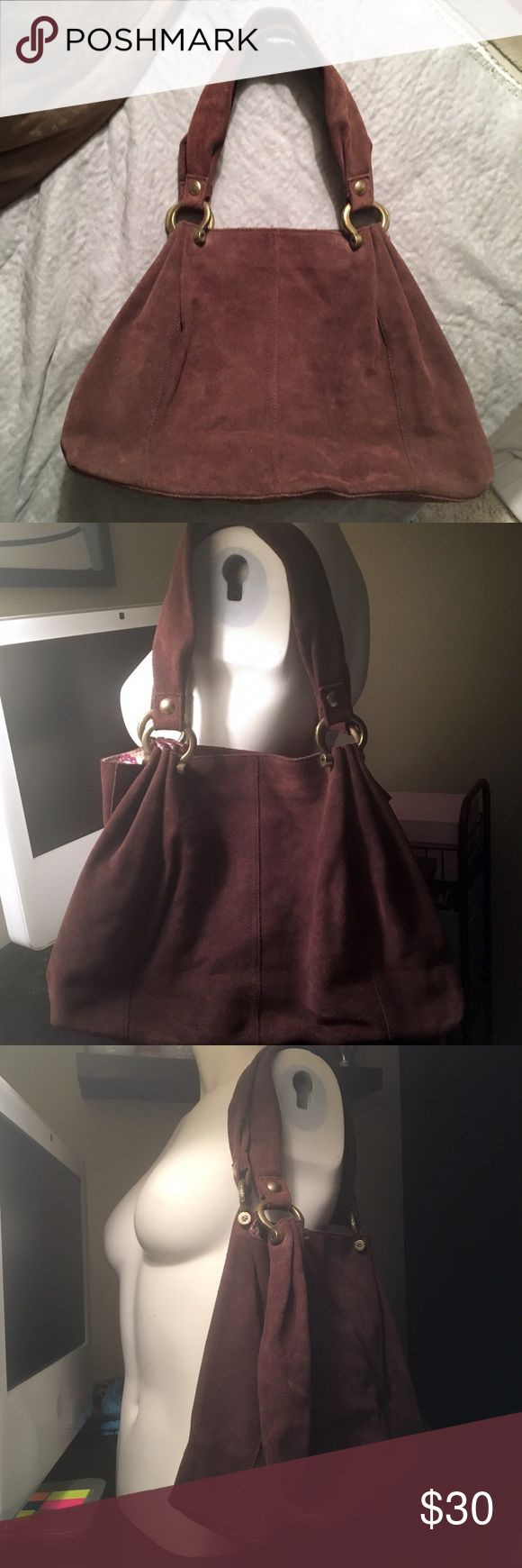Suede gap handbag Brown suede gap handbag. In good condition mag snap closure. Has a small rip inside and outside on bottom of bag that's been sewn together. I took pictures where are you can see it. GAP Bags