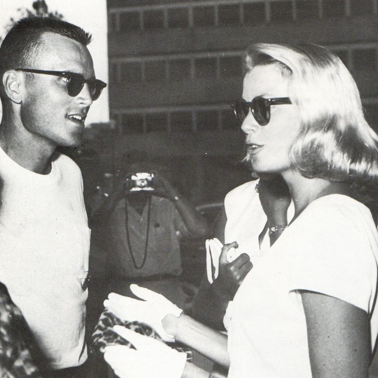 Princess Grace talks with her brother John B. Kelly Jr. during the Olimpics in Rome, 1960.