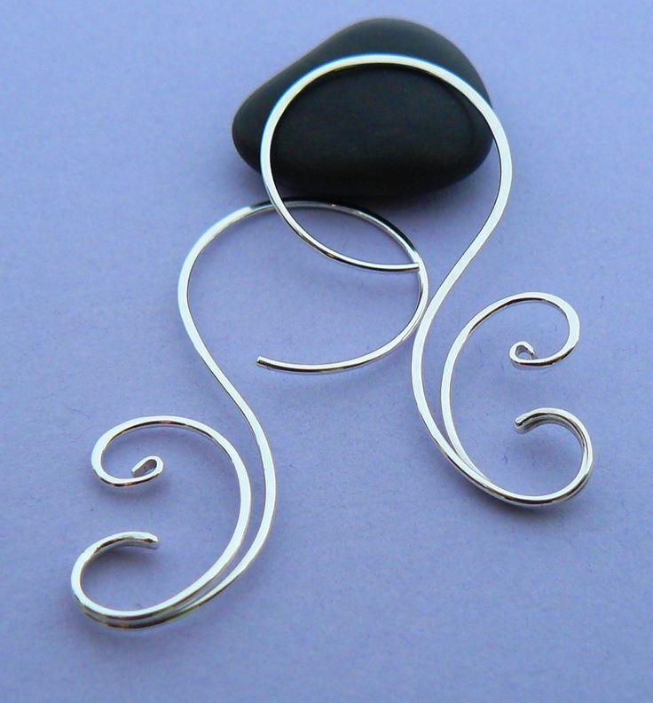 Silver hoop earrings | JewelryLessons.com