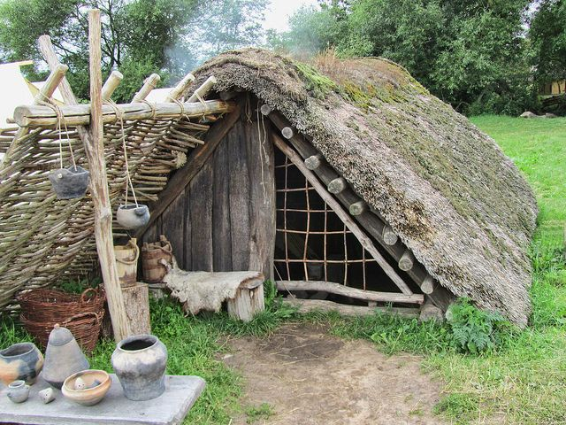Door to Viking hut with thatched roof at the Viking Center of Ribe, Denmark.
