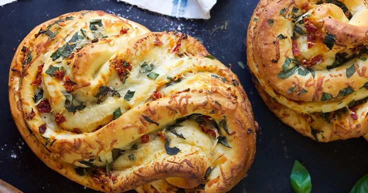 This impressive braid is filled with fresh basil and garlic, sun-dried tomatoes, and shredded cheese.