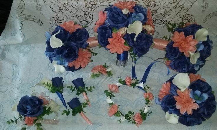 This package deal is made with Open Royal Blue Roses, Coral Dahlias, Cream Calla Lilies, and sea shells. Comes with One Brides Bouquet,2 Maid Bouquets, One Toss Bouquet, One Grooms Boutonniere, Two Groomsmen Boutonnieres, One Corsage, Flower Girl Head Piece, and One Hair Comb. Piece can be exchanged for item you need like extra Bouquet or Boutonnieres and Corsages....Price $200.00
