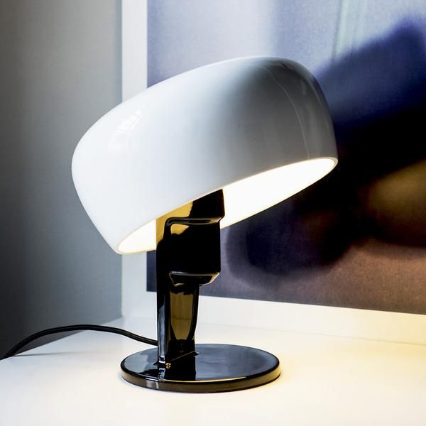 The timeless design of the Coppola table lamp by Formagenda is also highly functional, as the shade can be tilted around the bulb to direct light at any angle.