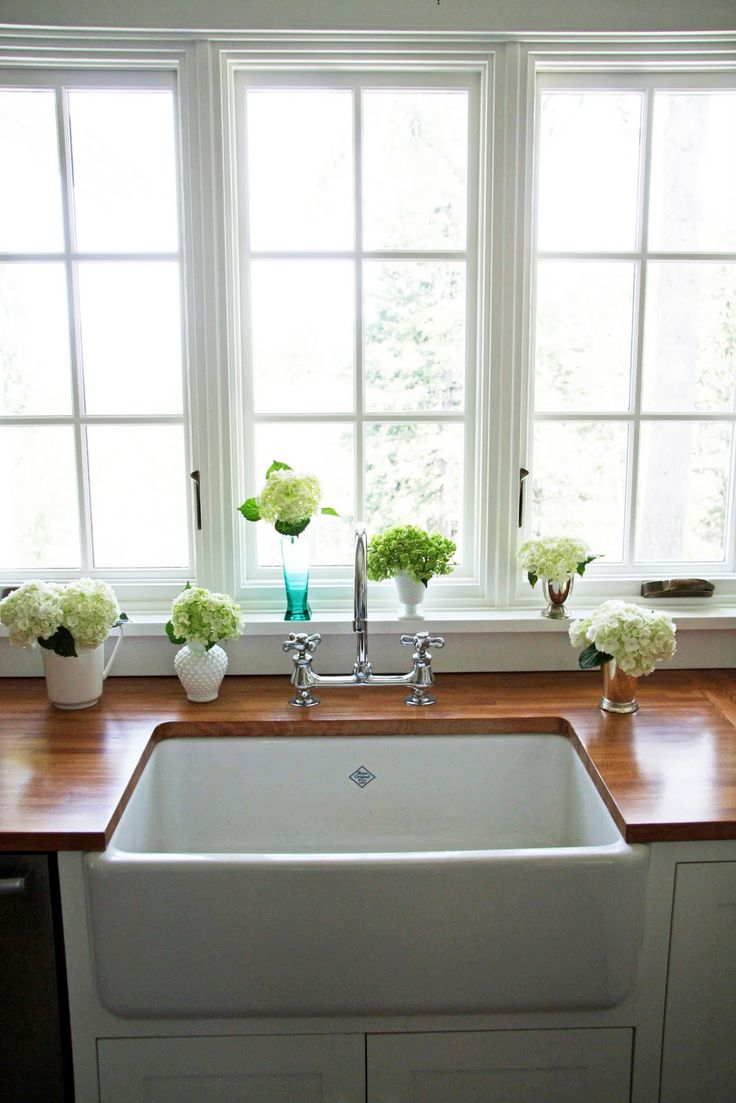 farmhouse sink and wood countertops