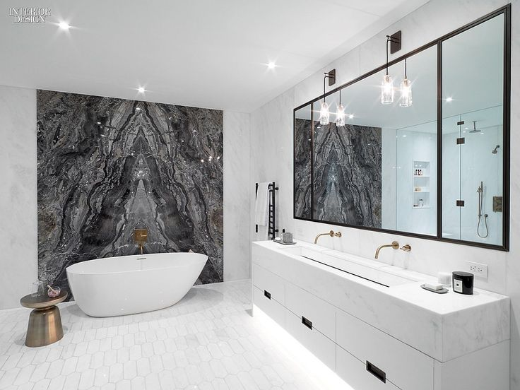 30 Simply Amazing Interiors at NYC Residences | Projects | Interior Design black marble stone slab bathroom walls accent wall tub