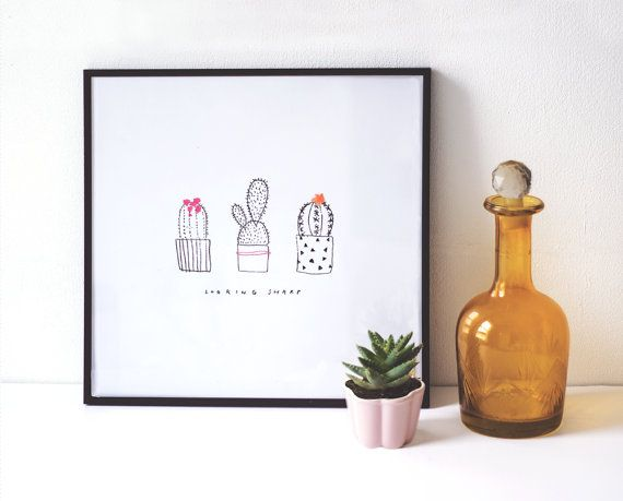 Fun, illustrative cactus print with the phrase Looking Sharp. This naive drawing will brighten up any corner of your home.    Frame and