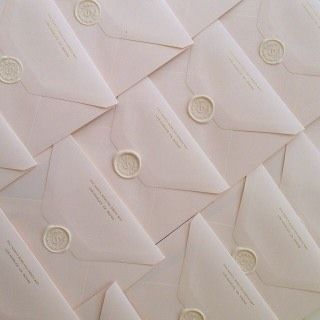 FOR THE STATIONARY    White wax seals on white envelopes    NOVELA BRIDE...where the modern romantics play & plan the most stylish weddings... www.novelabride.com #jointheclique @novelabride