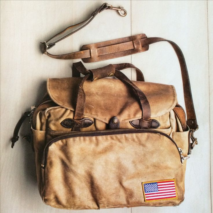 """The cover model on the April 2014 """"Luggage & Bags"""" catalog from #Filson. I'm going to get one of these (it's #70258), sew on an American flag patch, and beat the hell out of it until I'm dead. Then my kids/grandkids/godkids get it, and the cycle repeats."""