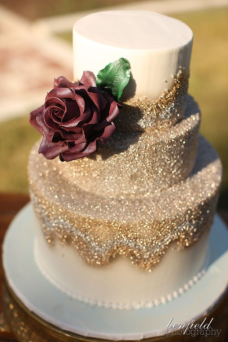 Gold sparkle wedding cake by Shelby Lynns' Cake Shoppe. Love the ash red rose! Enjoy RushWorld boards,  WEDDING CAKES WE DO, UNPREDICTABLE WOMEN HAUTE COUTURE and IN YOUR FACE GUERILLA MARKETING.  See you at RushWorld on Pinterest! New content daily, always something you'll love!
