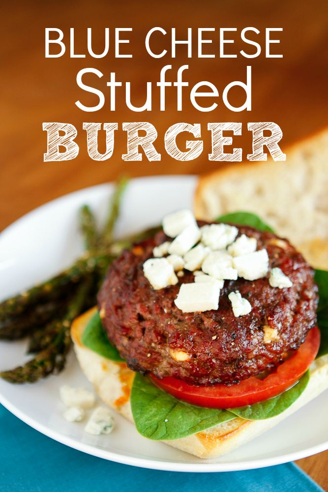 Buffalo Blue Cheese Stuffed Burgers -- wow your guests with these blue cheese filled burgers, topped with a drizzle of homemade buffalo sauce!