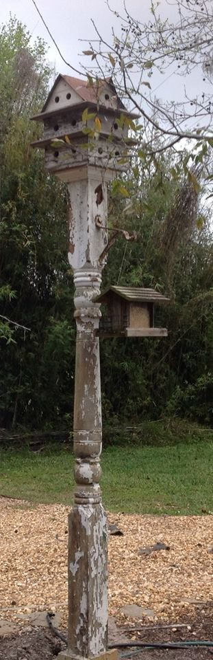 Bird hotel and feeder on a salvage pillar post.