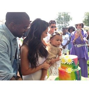 """North wore fringe and a flower crown. The cake was tie-dyed. 