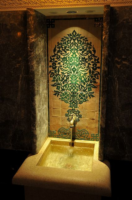 Traditional styled emerald tile, love how it incorporates the faucetry!