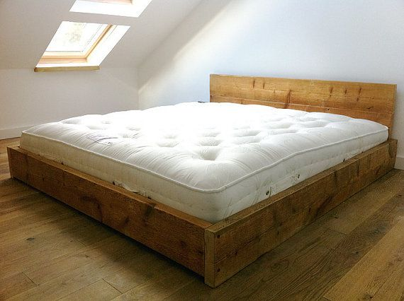 This bed frame is made with new scaffolding redwood boards, which create a rustic look, as unlike our other beds, the planks are planed less. The wood is finely sanded, so smooth to the touch but the bed has a slightly more rustic appearance as a result.  The head board is roughly 66cm in height and the foot end and sides are 22cm high.  If you have specific requirements, I will be happy to give a quote.  This slats sit roughly 18cm off the ground. On a mattress with a thickness of 20cm…