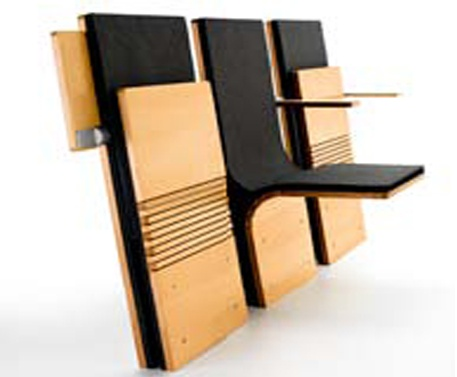 The JumpSeat is a compact auditorium chair that is ideal for auditoriums, theatres and public  assembly areas. Plywood and steel create the backbone of the JumpSeat's cantilevered structure. Folding  to less than four inches thick when not in use, the compact seat allows for the maximum amount of people  in the minimum amount of space.    Optional Extras: Armrests, writing tablets