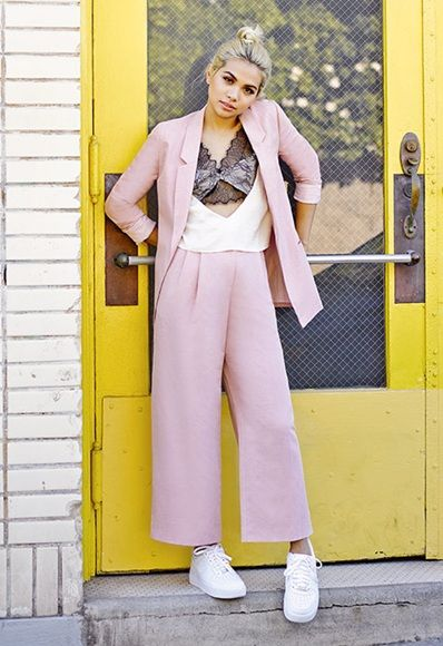 Hayley Kiyoko wearing pink trouser suit and lace top