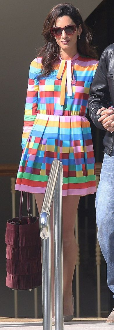 Who made  Amal Clooney's purple suede fringe handbag, sunglasses, tan suede pumps, and rainbow stripe dress?
