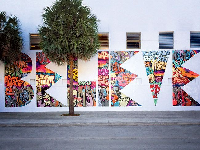 Although the organizers didn't want graffiti (seeing it as an open invitation for anybody with a spray can), the artist bombarded a wall with Miami-centric tags and then whited everything out except for the BELIEVE, elevating the everyday.