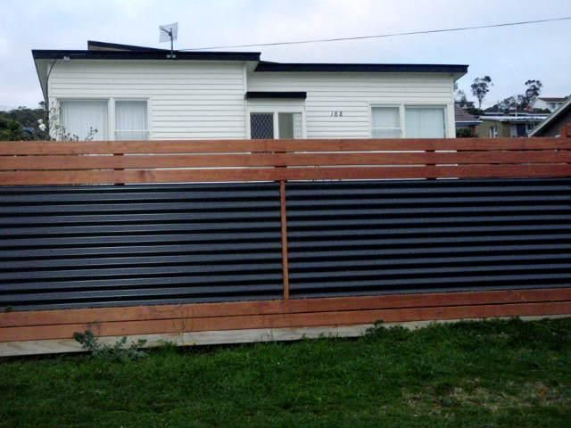 Contemporary horizontal wood fence with corrugated steel for Horizontal metal siding