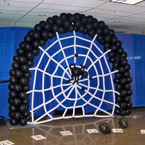 Halloween Balloon Arch - Oooh, scary with that black spider in the middle.  #Halloween #BalloonDecor