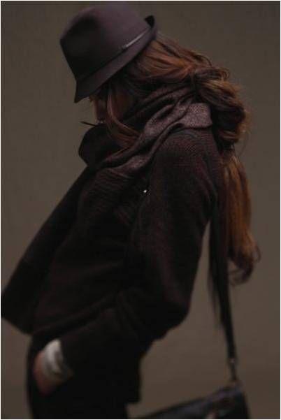 Brown hat. beautiful long auburn hair.