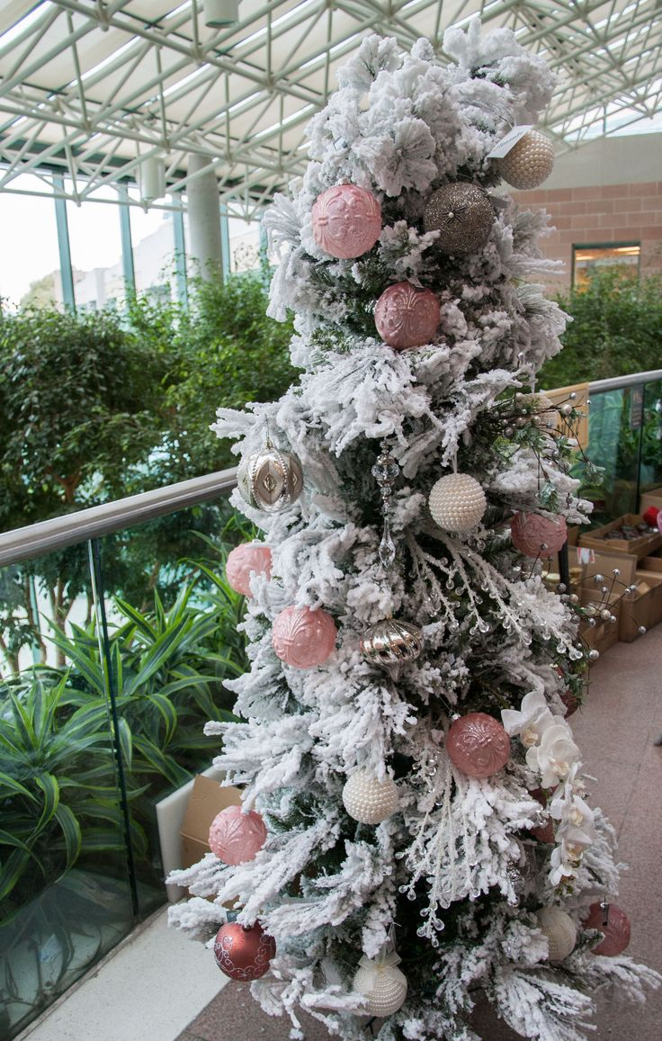Christmas tree inspiration: white, silver and pink decorations. Taken at the Homes for the Holidays House Tour.