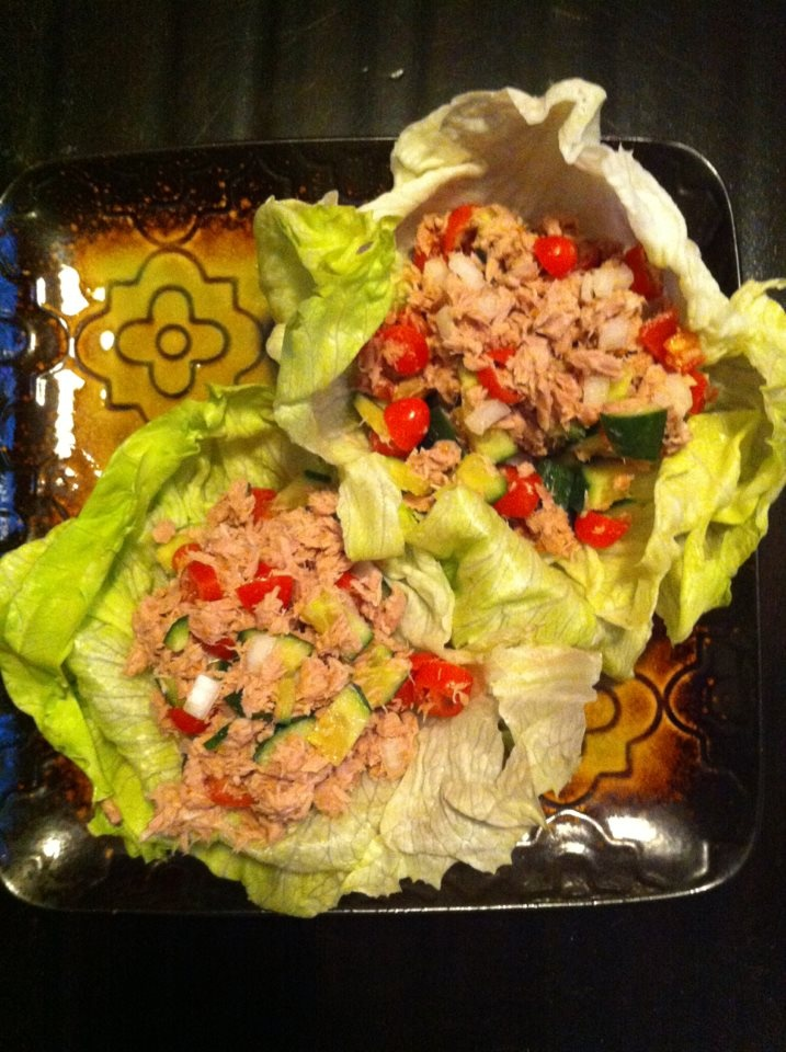 Six-Pack Tuna Wrap  1-Can of tuna  10-cherry tomatoes   1/2-diced cucumber  1/4-chopped onion   Tbsp-Low Fat Mayo  Dash of Salt, Pepper, Paprika   Iceberg Lettuce    35g protein - 4g fats - 14g Carbs
