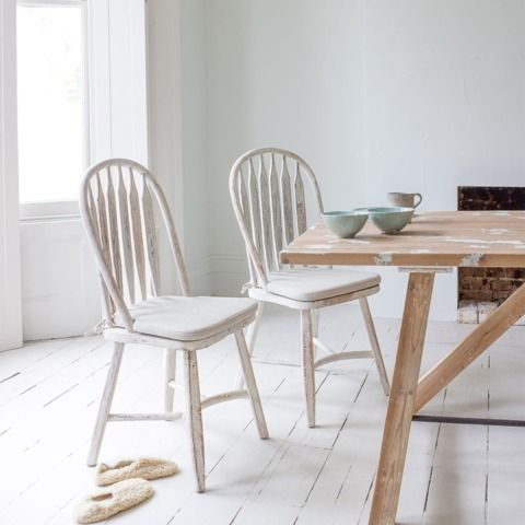 """BOSSY: """"Stand back! I've found it. Just leave it exactly as it is!"""" said our Charlie when he unearthed this ridiculously comfy chair. The distressed vintage paint finish means that it goes equally well with a natural timber table or painted one. Goes well with our Strappy & Speakeasy kitchen tables. Sold in pairs."""