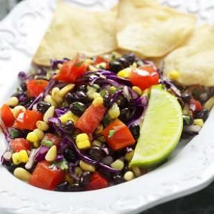 "Southwestern Corn & Black Bean Salad Recipe..""Here's a great make-ahead dinner--and leftovers are welcome for lunch the next day. If you make it ahead, don't add the salt and pepper until just before serving. That way, the salt won't render the vegetables soggy and the pepper won't lose its bite. Make It a Meal: Scoop up this salad with warm corn tortillas."" (I think I would add diced avocado, too)"