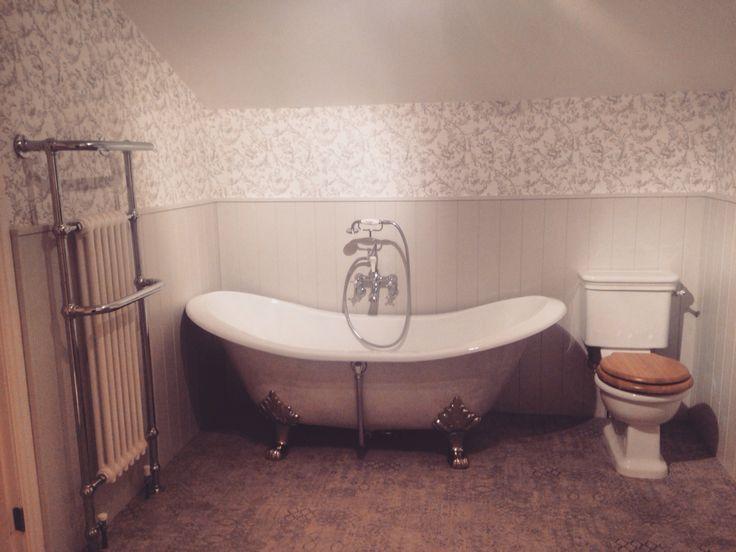 Popular Cast iron roll top bath painted in farrow u ball then sponge painted metallic silver