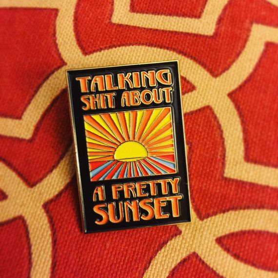 Gold metal soft enamel lapel pin inspired by Modest Mouses Talkin Shit About a Pretty Sunset. Includes rubber pin keeper backing.