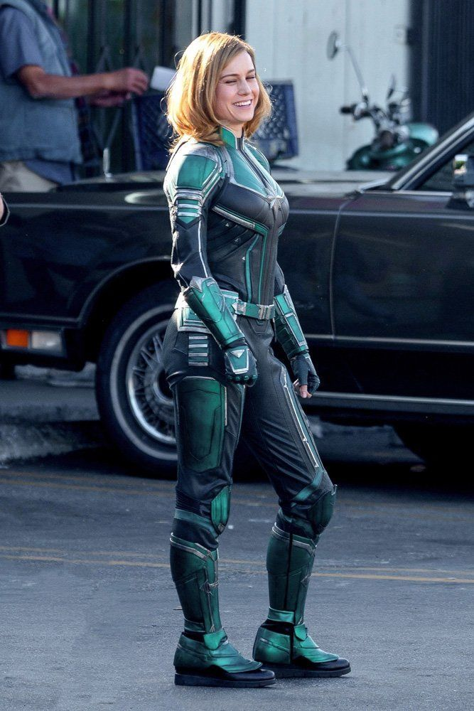 Set photos from the upcoming Captain Marvel film feature Brie Larson in her superhero suit.