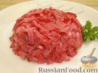 Фото к рецепту: Салат из свеклы и кальмаров