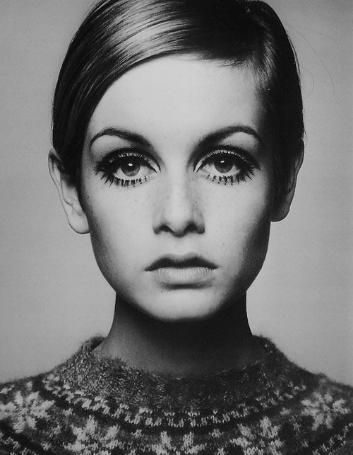 Twiggy. The '60s went back to the '20s bob hair cut again, and focus was more on the eyes...mascara was applied heavily on the upper and lower lashes, lips became nude or very light pink