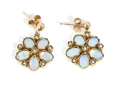 EARRINGS  Gold. 9 K.  Shaped like flowers made with 10 opals and 12 half pearls. Total weight: 4.4 g.  C.1900.  HEIGHT 2.5