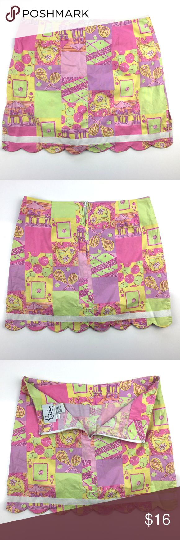 "Lily Pulitzer tennis skort in size 4 Description:  An excellent used condition Lily Pulitzer tennis skort in size 4. With tennis print in pink, green and yellow.  Dimensions:  Length:- 15"" Waist:- 14.5""  Thanks for viewing! Lilly Pulitzer Skirts"