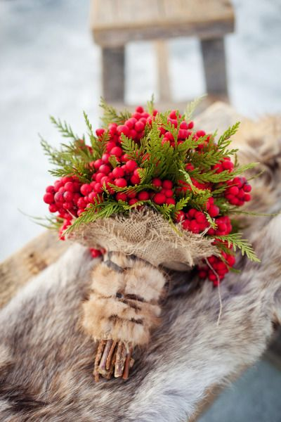 Unique Winter Wedding Bouquet Featuring: Red Berries, Green Cedar Hand Tied With Burlap, Rabbit Fur + Leather