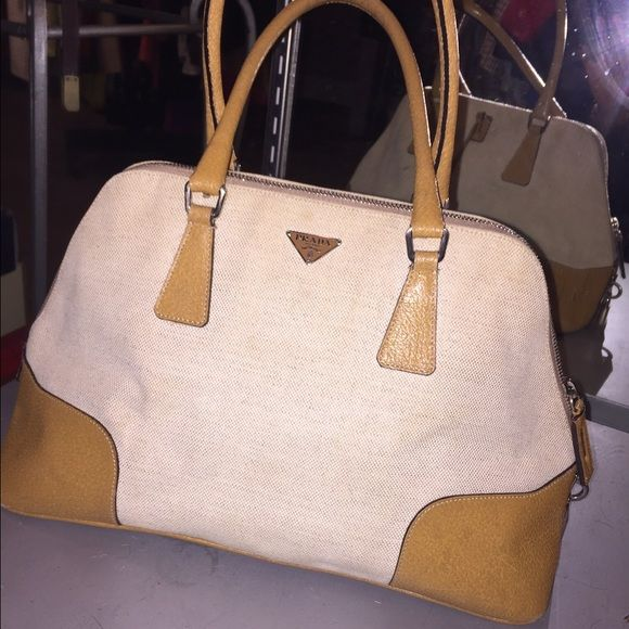 Prada handbag Light tan linen authentic Prada handbag looks like new. Only worn a few times. Inside is very clean with no marks, and this is a great buy! Prada Bags Satchels