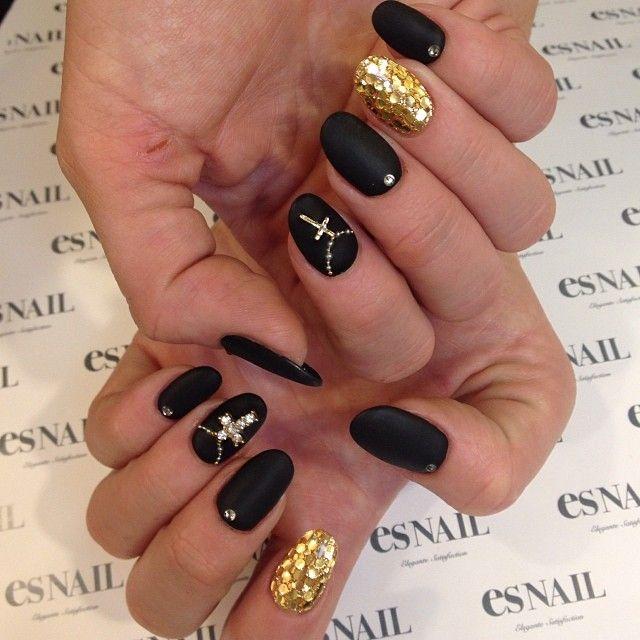 Matte black with gold hologram nails by kiko_mikiko