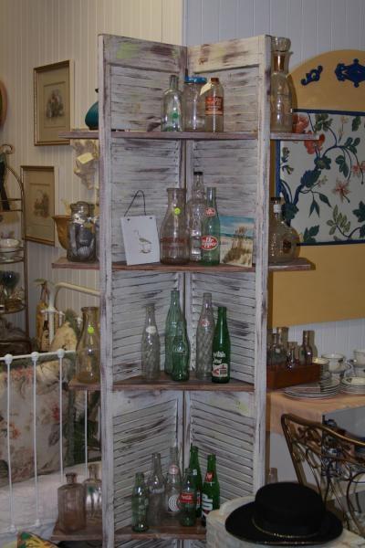 Corner shutter shelf. This would make a good plant shelf.