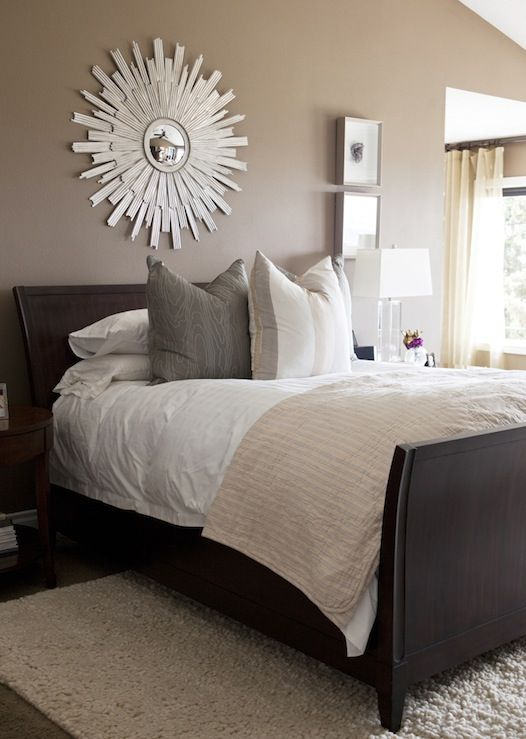 mocha walls espresso stained wood sleigh bed ivory wool rug gray silk pillows pink quilt sloped ceiling