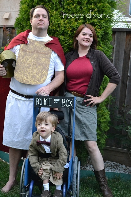 Rory the Roman, Amy Pond, and the Doctor.  Also add baby River Song?