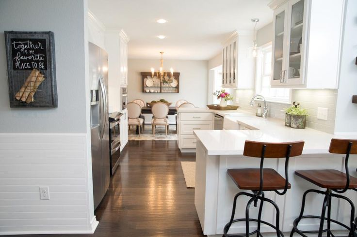 A fresh coat of paint throughout the space, white subway tile backsplash and updated fixtures brighten up the formerly dreary kitchen.